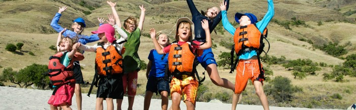 kids having fun rafting in Idaho