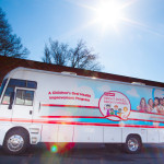 In honor of Black History Month, the Colgate Bright Smiles, Bright Futures mobile dental van provided free dental screenings today for children at the 1720 West Trade Street Family Dollar store in Charlotte, NC