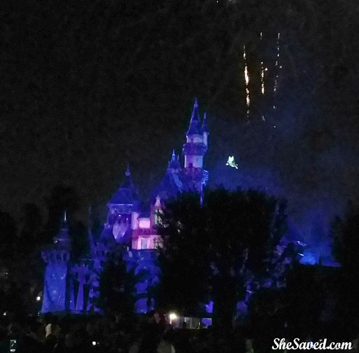 Tinker Bell flies around the castle as part of the Disneyland Firework Show