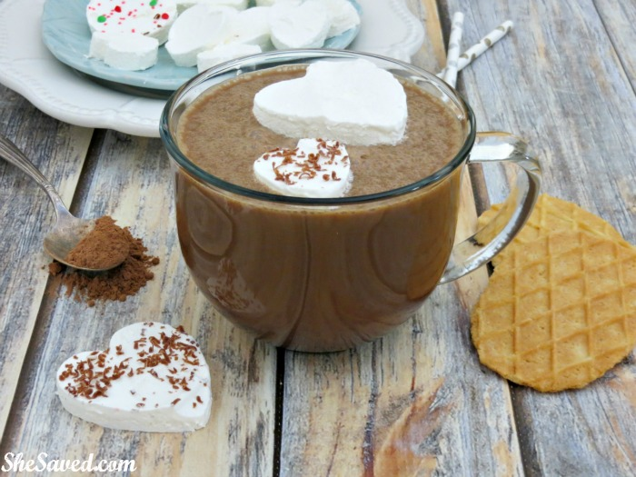 These fun Frozen Whipped Cream Hearts are easy to make and SO fun to enjoy as a holiday hot chocolate topper!