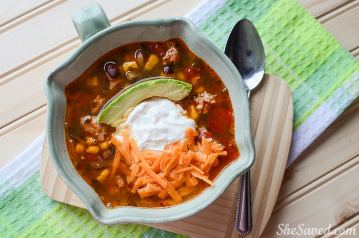 This Slow Cooker Chicken Taco Soup Recipe will be a favorite dinner recipe for your family! It's easy and so yummy!