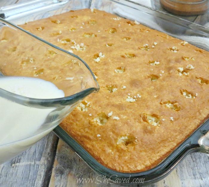 Pouring Cream into Poke Cake Recipe