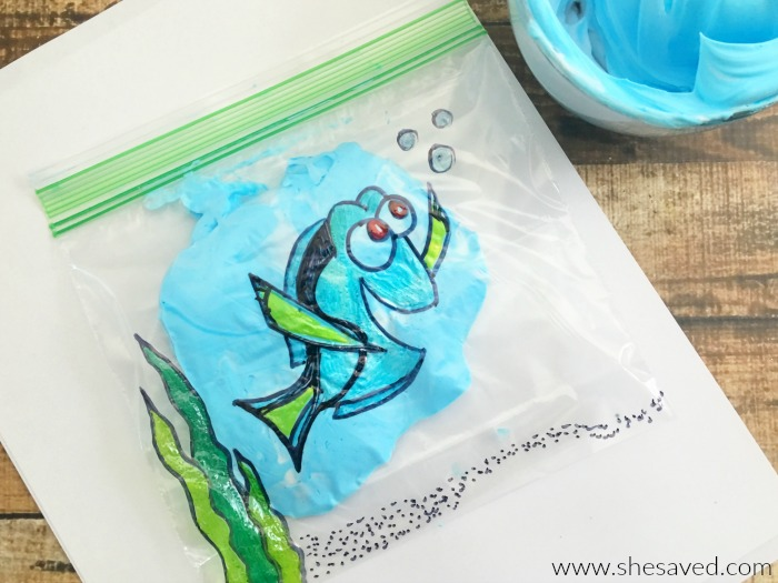 """Have little ones use their fingers to smash around the """"water"""" in this fun Dory Finger Paint craft!"""