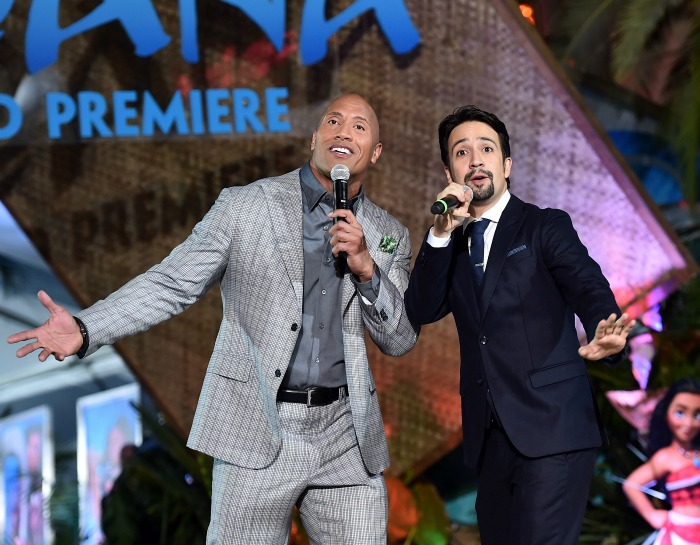 "Actor Dwayne Johnson (L) and songwriter Lin-Manuel Miranda perform onstage at The World Premiere of Disney's ""MOANA"" at the El Capitan Theatre on Monday, November 14, 2016 in Hollywood, CA. (Photo by Alberto E. Rodriguez/Getty Images for Disney)"