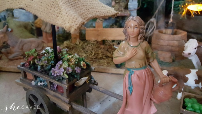 Flower girl with flower cart as part of the Fontanini Nativity collection and Christmas decor