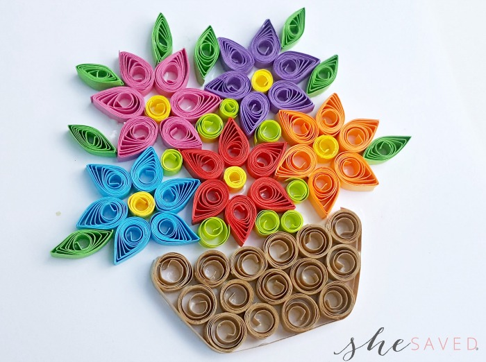 Paper quilling flower basket project shesaved you can use small coil patterns to fill the gaps between the flowers and the leaves add any other details as you wish mightylinksfo