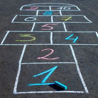 Hopscotch game drawn with chalk on the asphalt