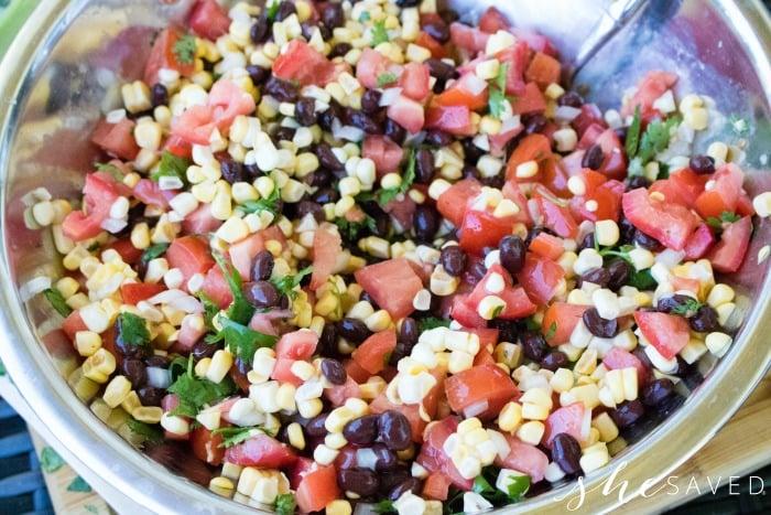 mixing homemade salsa