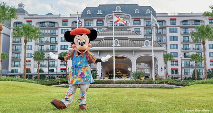 Mickey Mouse in front of a luxury Disney World hotel