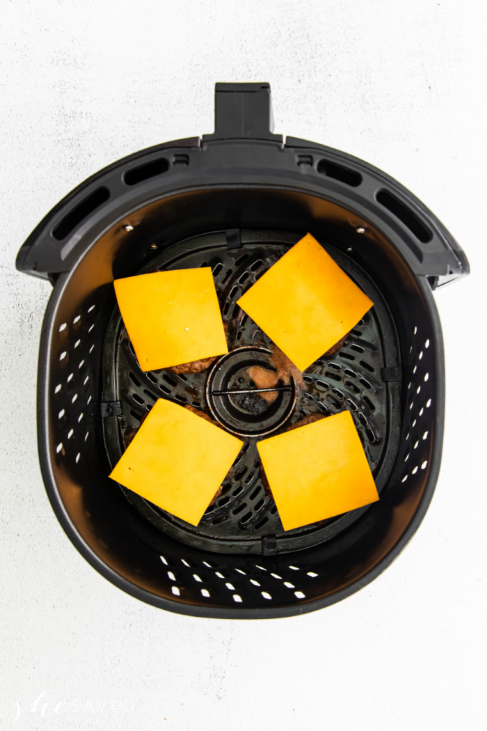 cheese slices on burger patties in the air fryer