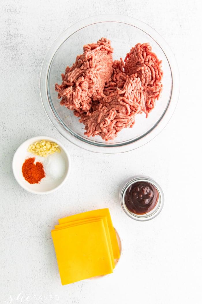 ground beef, seasonings, and sliced cheese for burger ingredients