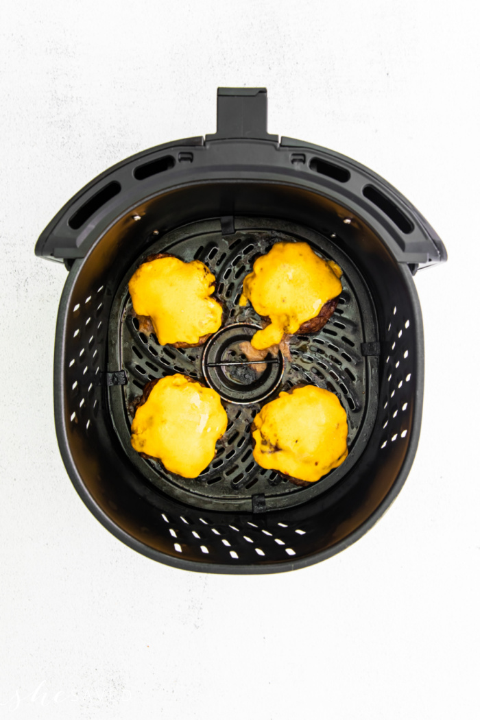 melted cheese on burger patties in the air fryer