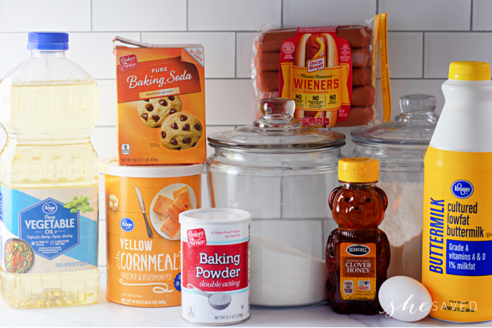 Ingredients for homemade Corn dogs batter: honey, oil flour, hotdogs and more