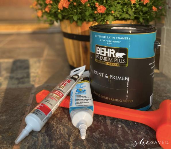can of Behr pain, plastic orange mallet and caulk