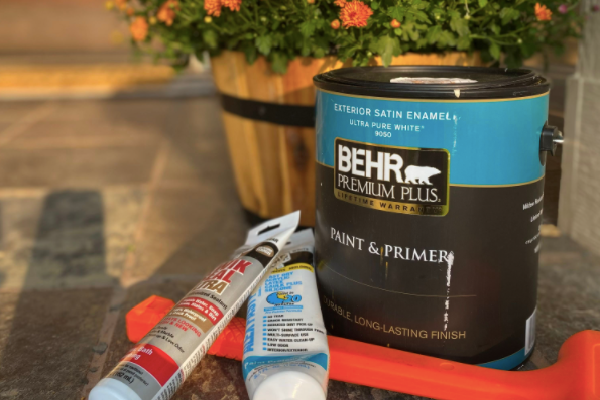 can of paint, two tubes of caulk and a rubber mallet