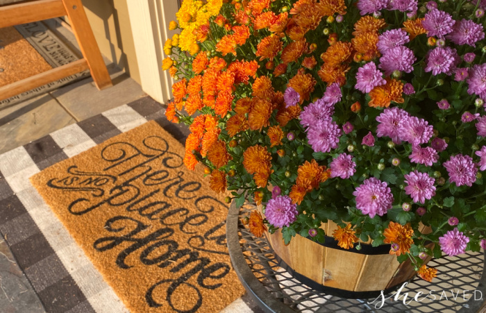 flowers by the entry of a home