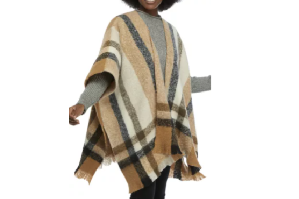 Black woman in plaid topper