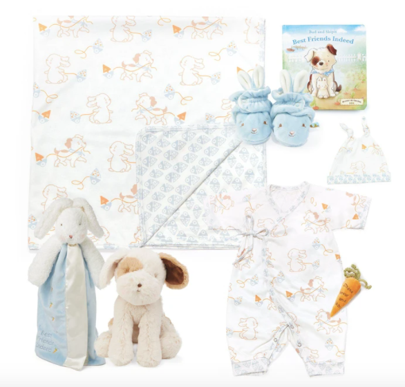 Assortment of baby blankets and plush toys