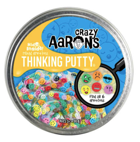 tin container of Crazy Aaron's putty with hidden things inside